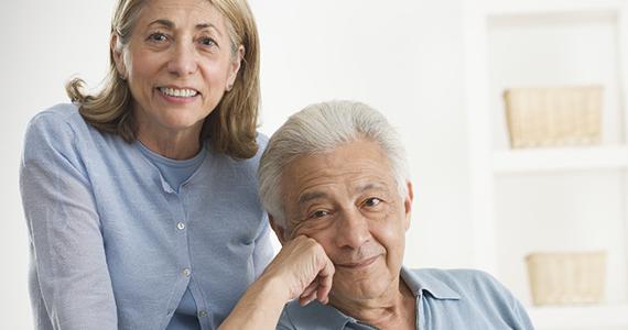 Older Latino couple at home