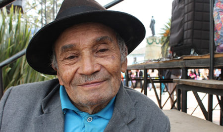 Older Latino man in hat