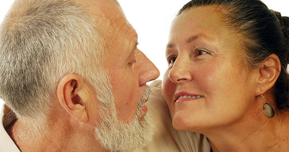 older Latino couple looking lovingly into each others' eyes