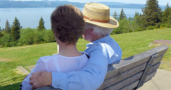 Older couple sitting outdoors on a bench