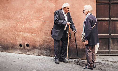 Older adults talking in the street