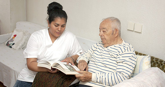 Caregiver taking care of older Latino man