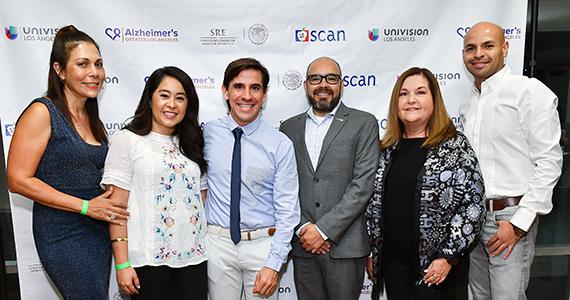 Aranda stands with group at El Cuidador event