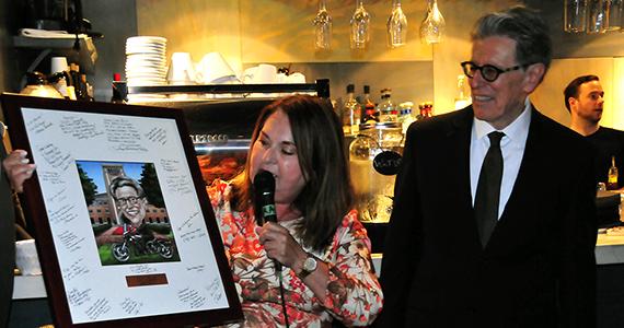 María Aranda gives William Vega's retirement gift