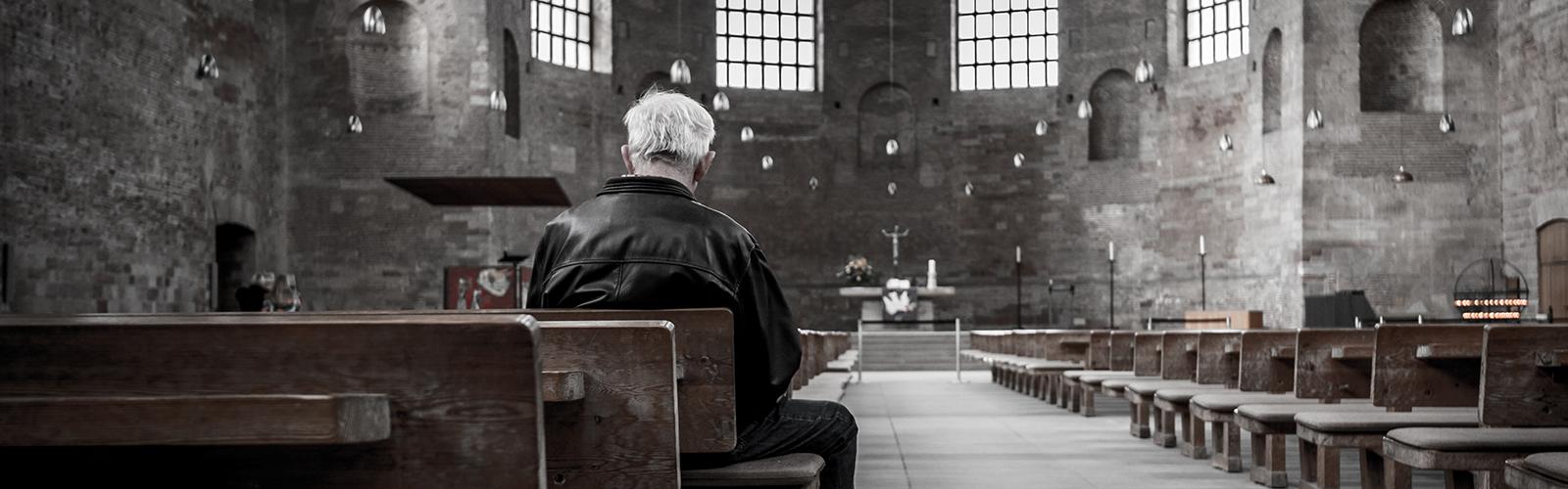 Old Man sitting in a church