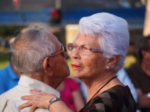 older latino couple dancing together