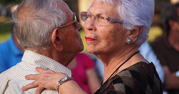 Older Latino couple dancing