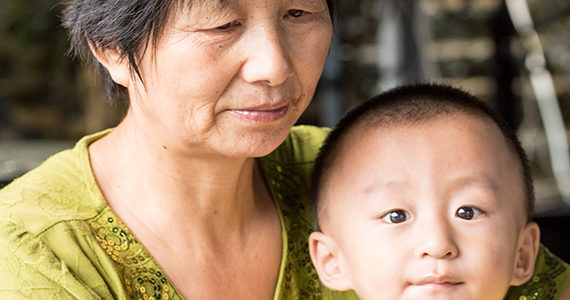 Asian grandmother with Asian grandson