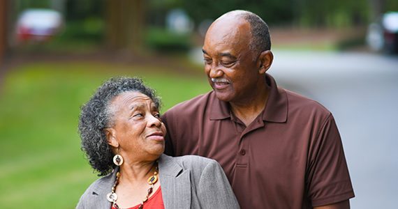 Older African American Man and woman posing together