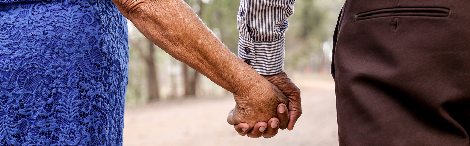 Older Latino couple holding hands
