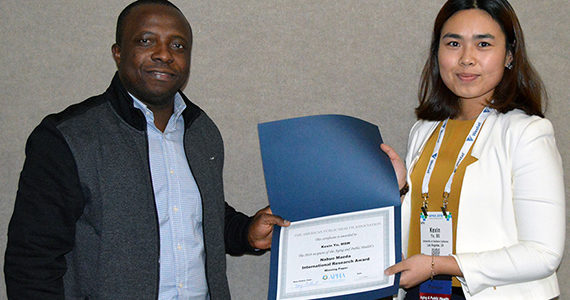 Kexin Yu accepts award at APHA meeting