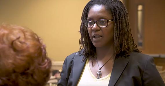 Karen Lincoln speaks to community member