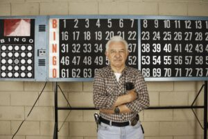 Man in front of a bingo board