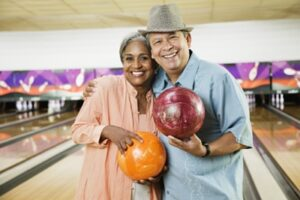 Photo of a smiling couple bowling