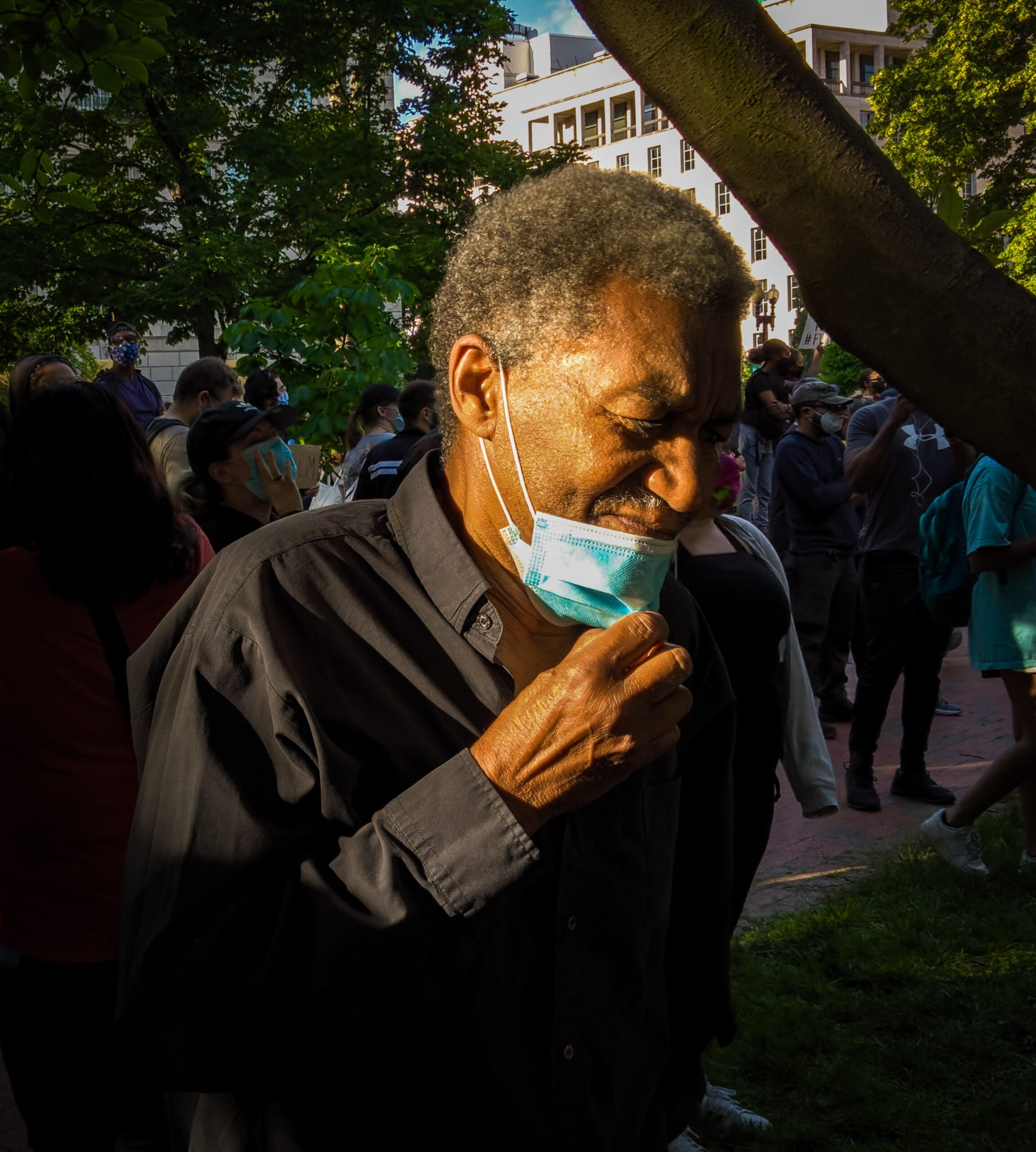 an elderly black man with a face mask