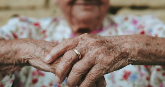 a close-up of an elderly man's hands